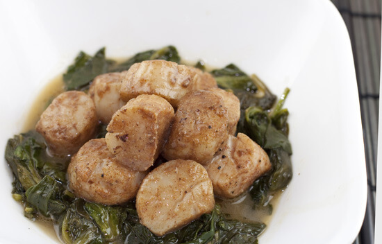 Five Spice Scallops over Sesame Spinach