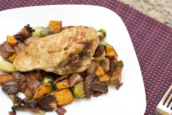 Bacon and Mushroom Stuffed Chicken Breasts over Sweet Potato Hash