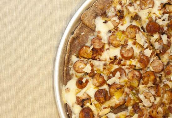 White Pizza with Sausage, Pancetta, Leeks, and Parmesan